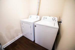 washer and dryer unit in enclosed closet
