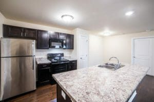 View of kitchen that is fully renovated with granite countertops and stainless steel appliances.