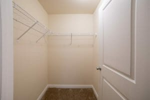 walk-in closets with wire wrack at top.