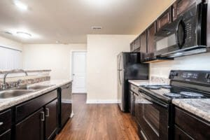 kitchen with dark cabinetry and marble looking counters