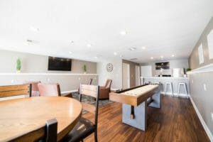 Common area with shuffleboard table, seating, and other amenities